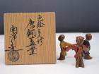 色絵三人形唐銅蓋置
